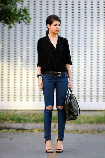 Девушка в джинсах, черной блузе с ярко накрашенными губами