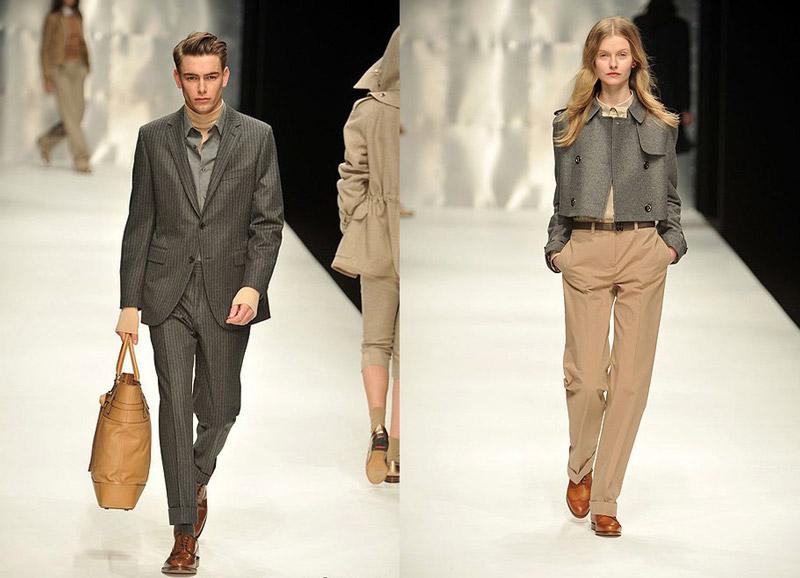 Молодой человек в сером костюме в вертикальную полоску, девушка в прямых бежевых брюках и сером укороченном жакете