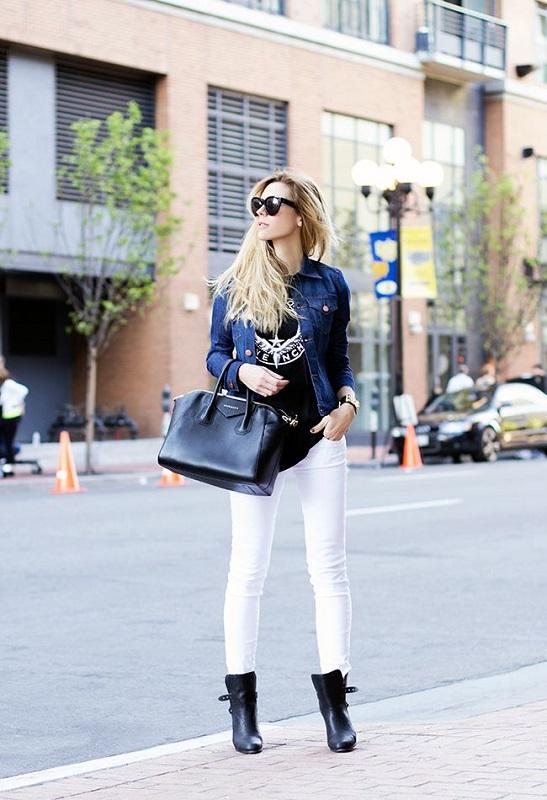 Девушка в белых джинсах, черной футболке и джинсовой куртке