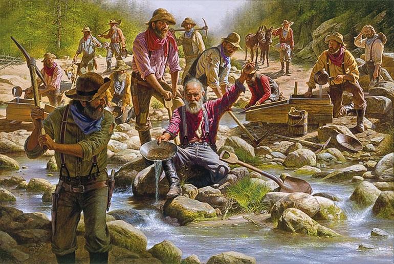 Золотоискатели в джинсах моют золото на реке