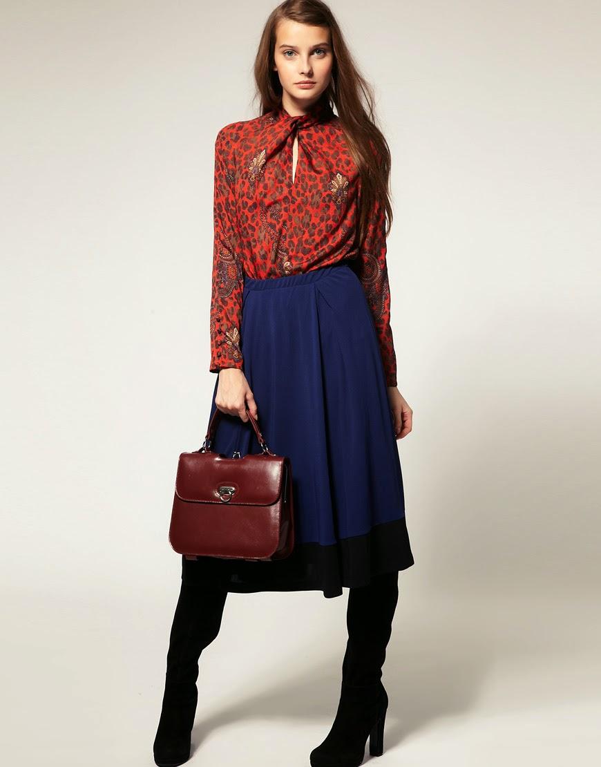 Девушка в юбке миди и леопардовой блузке