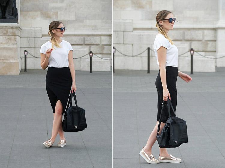 Девушка в черной юбке карандаш, белой футболке и золотистых слипонах