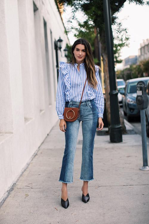 Девушка в двуцветных джинсах и полосатой блузе с оборками фото thriftsandthreads
