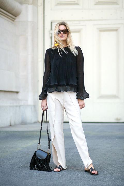 Camille Charriere в самых популярных среди уличных модниц Парижа широких брюках