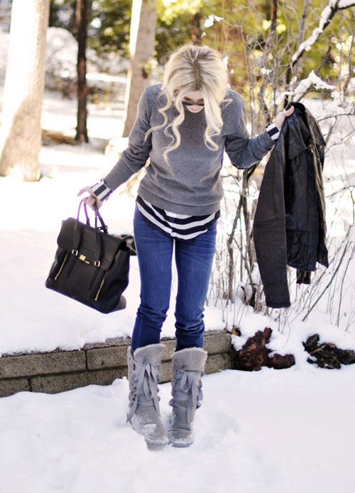 Девушка в серых зимних сапогах