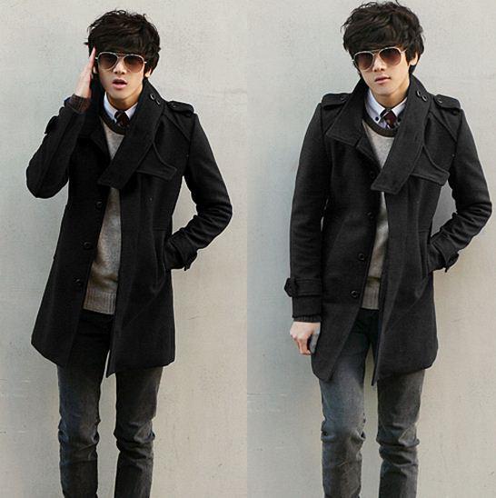 мужчина в черном пальто и темных очках