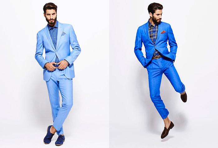 мужчина в голубо-синем костюмах
