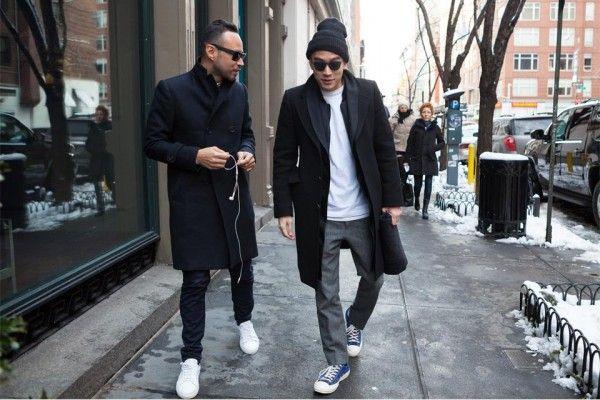 мужчины в черных пальто и очках