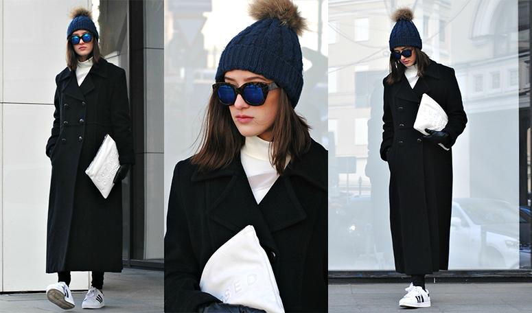 Девушка в черном длинном пальто