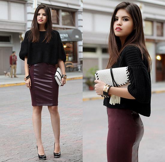 Девушка в юбке карандаш и черном свитере