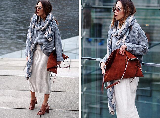 Девушка в сером свитере и юбке миди