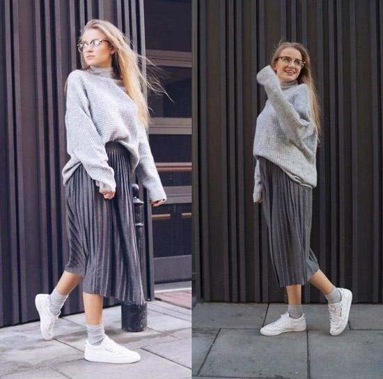 Девушка в свитере и плиссированной юбке миди