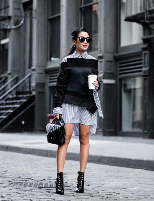 Девушка в платье рубашке и свитере