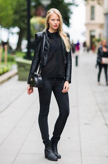 Девушка в черном луке с узкими брюками