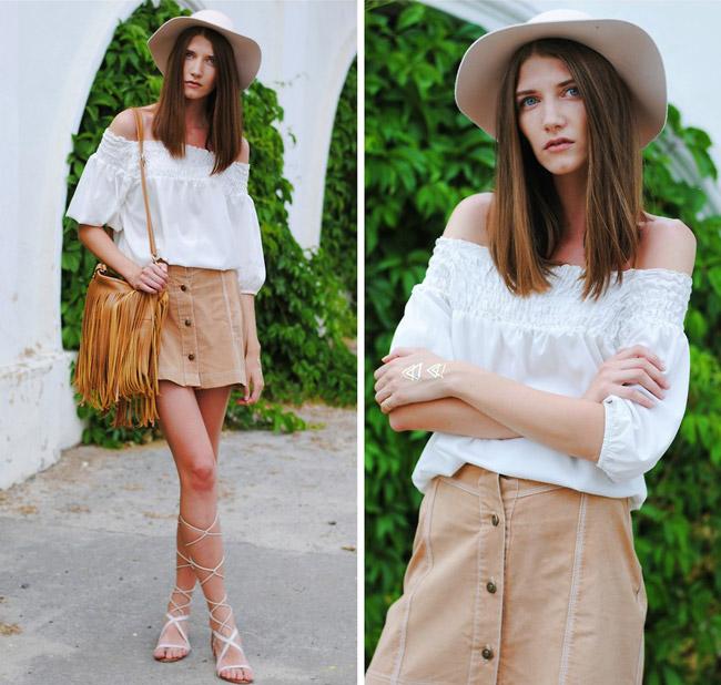 Девушка в бежевой юбке и белой блузке
