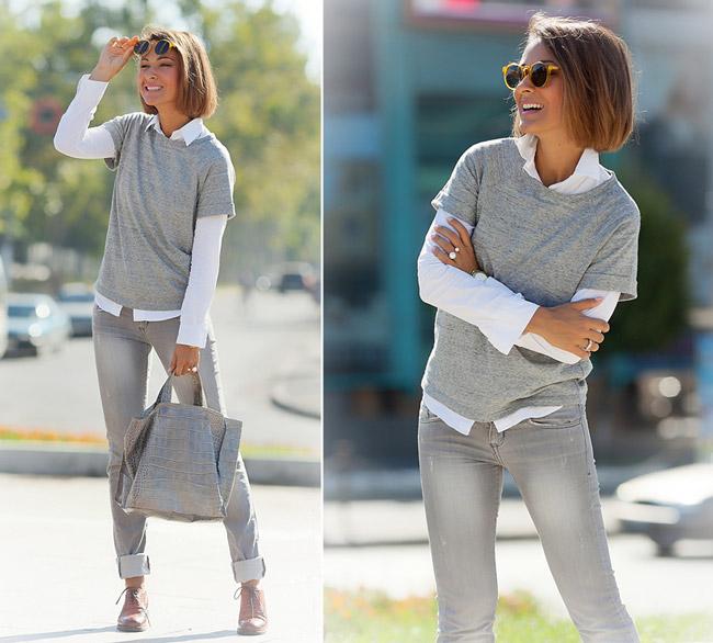 Девушка в сером джемпере и серых джинсах