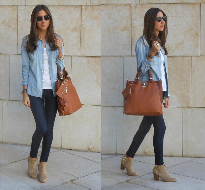 Девушка в в темно синих джинсах, рубашке и с коричневой сумкой тоут