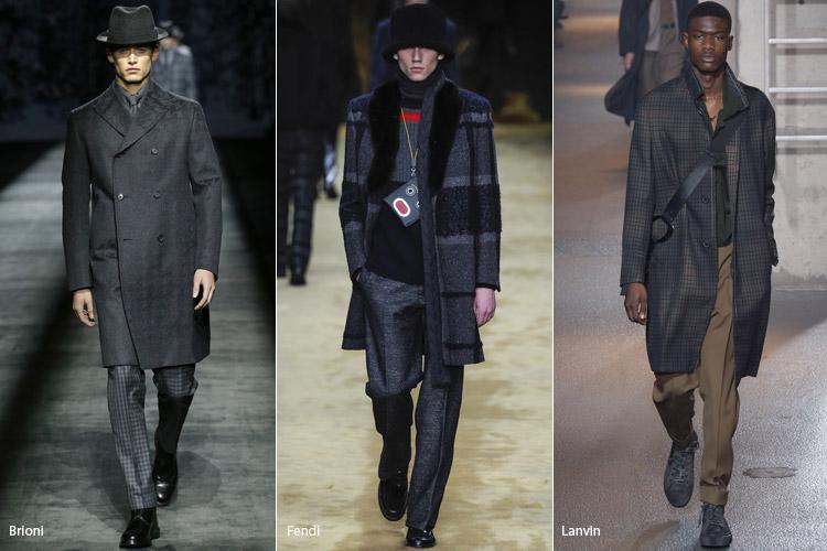 Мужчины в сером пальто в клетку