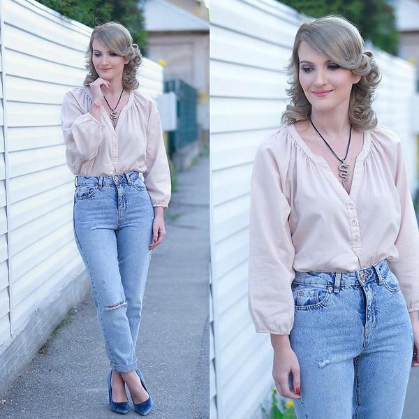 Модель в джинсах американках и блузке