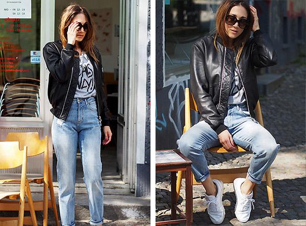 Модель в джинсах американках и кожаной куртке