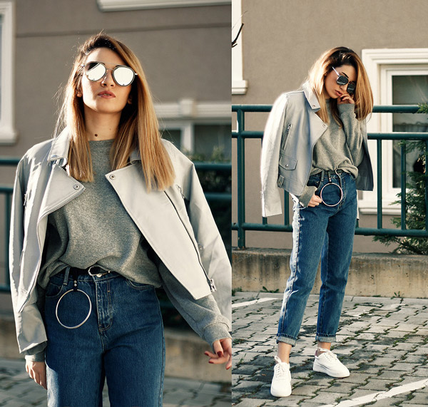 Девушка в мом джинсах и сером свитшоте