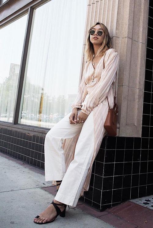 Блогер в белых брюках и асимметричной удлиненной блузе shhtephs