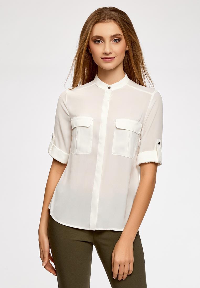 Девушка в белой блузке с накладными карманами