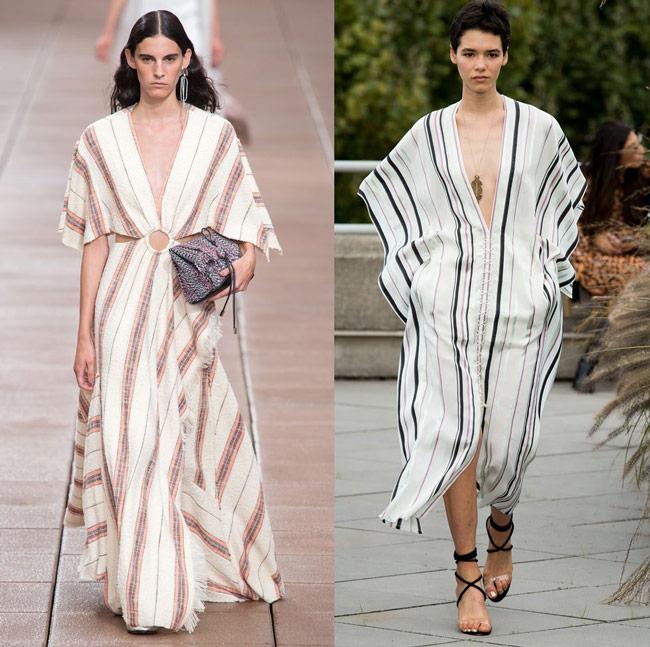 Модели в модных белых платьях макси с вертикальными полосами