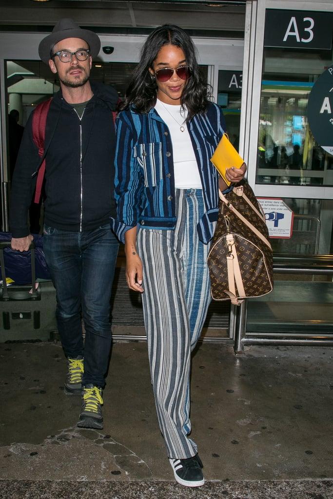 Laura Harrier в брюках в полоску, футболка и жакет