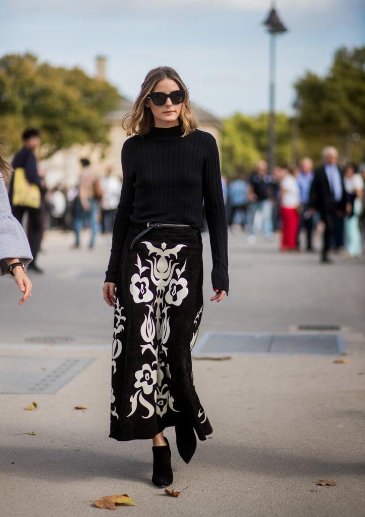 Оливия Палермо в черной водолазке и макси юбке с белыми узорами
