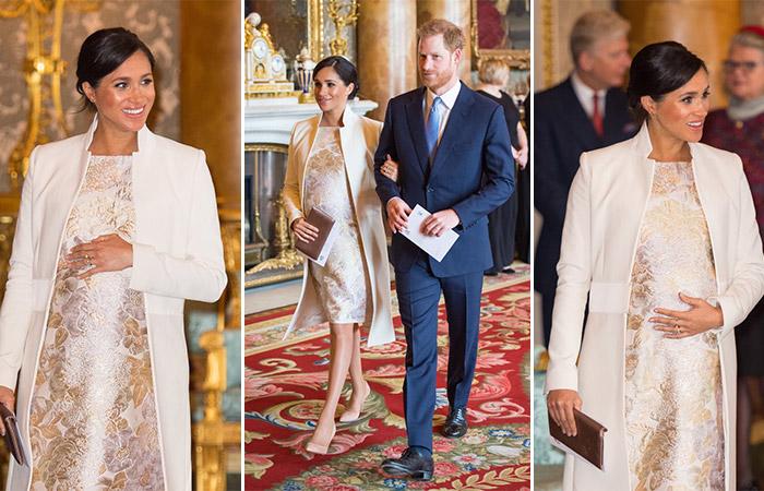Меган Маркл в золотом платье по колено и белом пальто