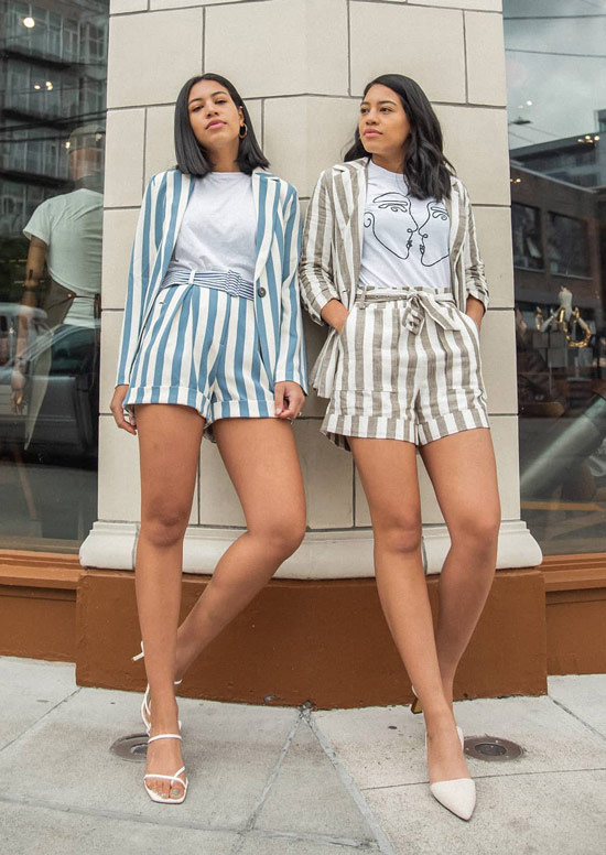 Девушки в костюмах в полоску с шортами