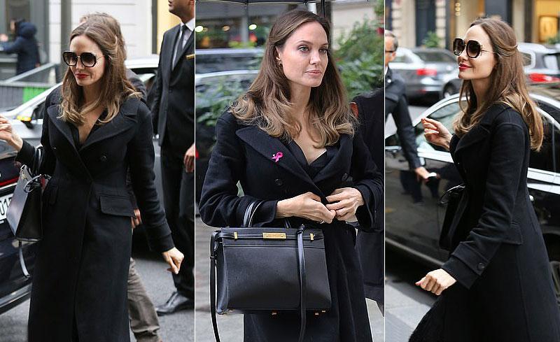 Анджелина Джоли в пальто и с классической сумкой в Париже