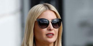 Иванка Трамп в бежевом пальто и солнцезащитных очках