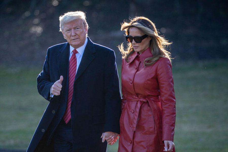 Мелания Трамп в красном кожаном плаще и солнцезащитных очках