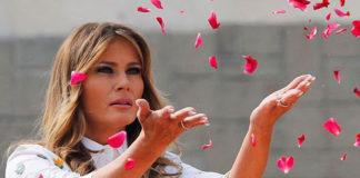 Мелания Трамп в белом платье с цветами, красном поясе и туфлях выглядит очаровательно
