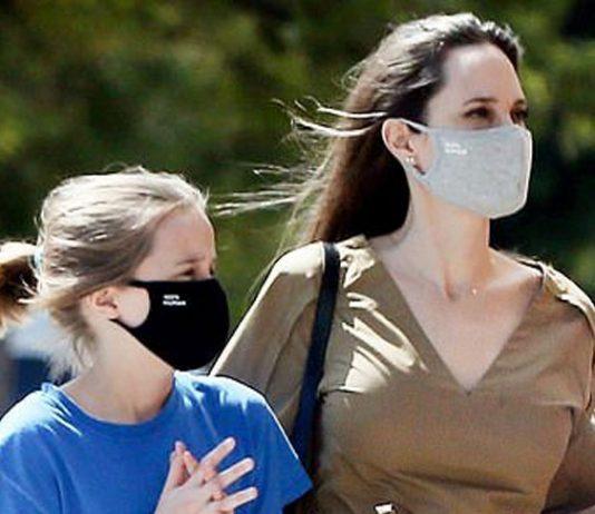 Анджелина Джоли в оливковом платье с поясом и пантолетах выглядит свежо и уверенно