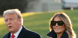 Мелания Трамп в двубортном пальто до колен и высоких сапогах выглядит безупречно