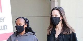 Анджелина Джоли в узких джинсах, ботильонах и пальто вместе с дочкой пробежалась по магазинам