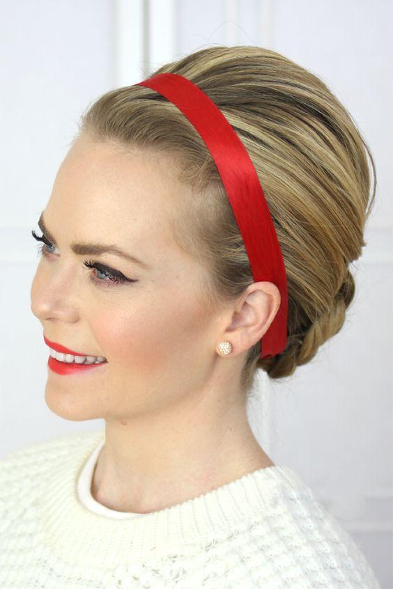 Девушка со светлыми волосами аккуратно собранными сзади с красной повязкой