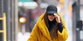 Ирина Шейк в пальто, похожем на халат, и армейских ботинках привлекает внимание фотографов