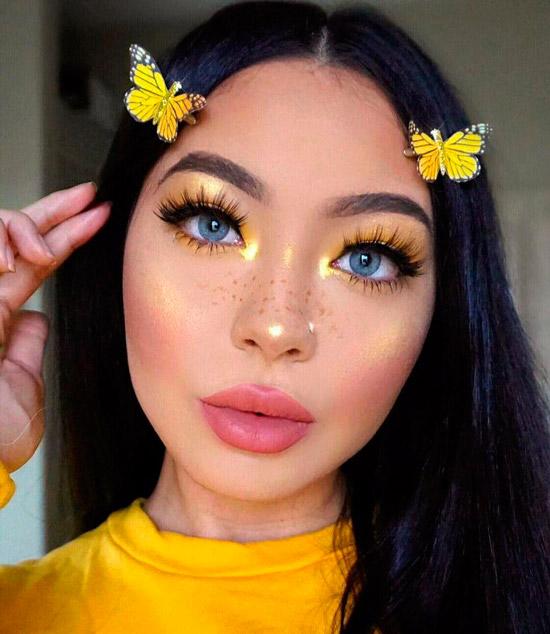 Девушка с желтым весенним макияжем, темные волосы с пробором по середине