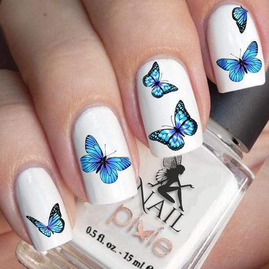 Красивые бабочки на белых ногтях