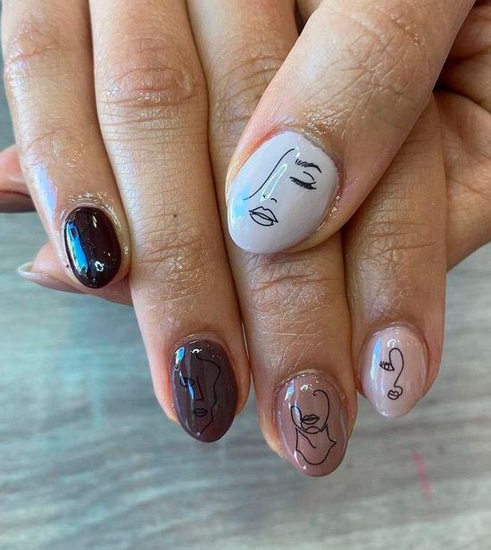 Бежевый маникюр омбре с художественным принтом на овальных ногтях