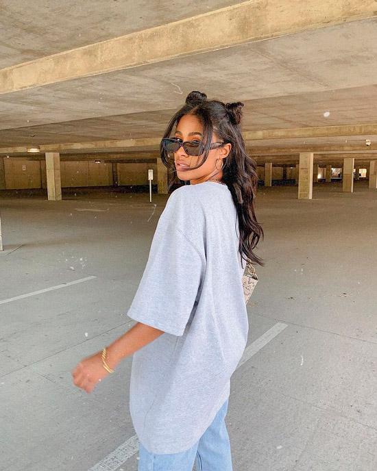 Девушка с длинными натуральными волосами с легкими волнами и пучками