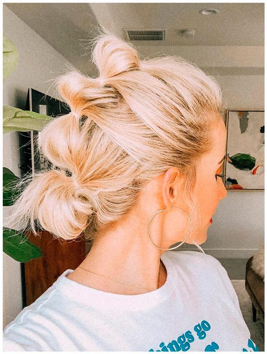 Девушка с воздушной косой на светлых волосах
