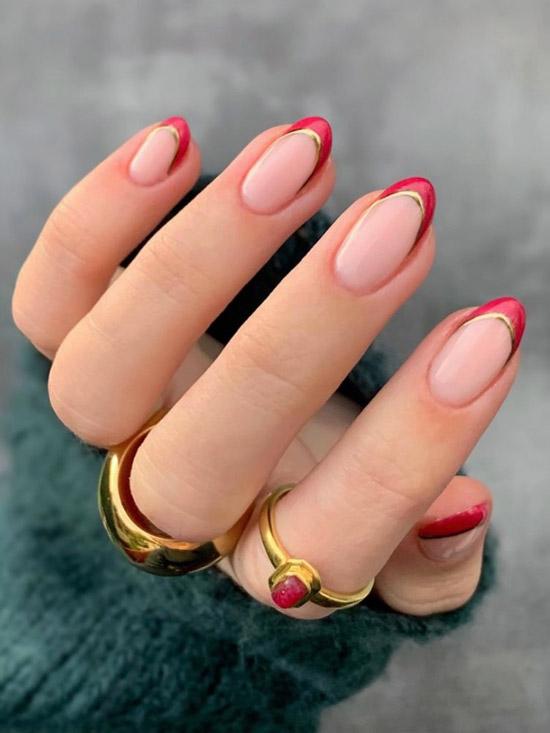 Красный френч с золотом на овальных ногтях средней длины