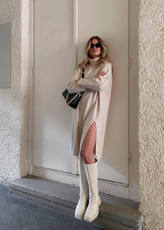 Девушка в уютном платье свитер и белых сапогах