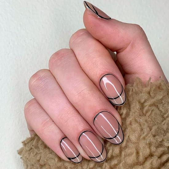 Графический френч на овальных ногтях средней длины